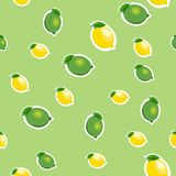 Seamless pattern with small lemons and limes with green leaves. Light green background. Stock Photos