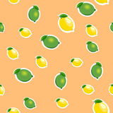 Seamless pattern with small lemons and limes with green leaves. Orange background. Stock Photo