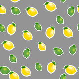 Seamless pattern with small lemons and limes with leaves. Gray background. Stock Photography