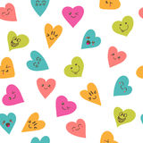 Seamless pattern with smiley hearts. Cute cartoon characters Royalty Free Stock Images