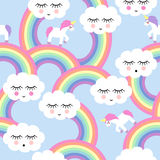 Seamless pattern with smiling sleeping clouds and rainbows Stock Image