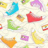 Seamless Pattern with sneakers. Seamless Pattern with multicolor sneakers and music cassettes Stock Photo