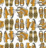 Seamless  pattern with sneakers Royalty Free Stock Photos