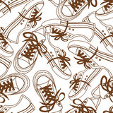 Seamless pattern of sneakers Stock Photos