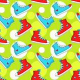 Seamless pattern with sneakers. Vector background. Royalty Free Stock Photo