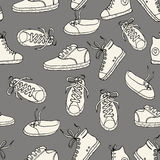 Seamless pattern with sneakers Vector background. Stock Photography