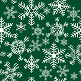 Seamless pattern with snowflakes on a background Royalty Free Stock Images