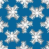 Seamless pattern with snowflakes on the background Royalty Free Stock Images