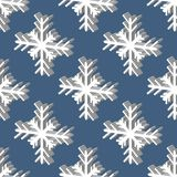 Seamless pattern with snowflakes on the background Royalty Free Stock Photography
