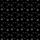Seamless pattern of snowflakes on a black background. Eps 10 Stock Photography