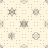 Seamless pattern of snowflakes, black on beige Royalty Free Stock Photography