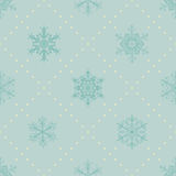Seamless pattern of snowflakes, blue on light blue Royalty Free Stock Photo