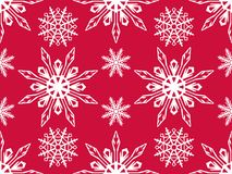 Seamless pattern of snowflakes. Christmas ornament. The festive mood Royalty Free Stock Images