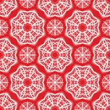 Seamless pattern of snowflakes. Christmas ornament. The festive mood Stock Photography