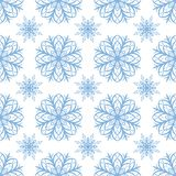 Seamless pattern of snowflakes. Christmas ornament. The festive mood Stock Image