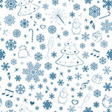 Seamless pattern with snowflakes and Christmas sym Stock Photography