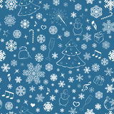 Seamless pattern with snowflakes and Christmas sym Stock Images
