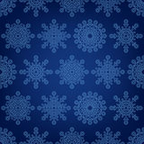 Seamless pattern of snowflakes on a dark backgroun Royalty Free Stock Image