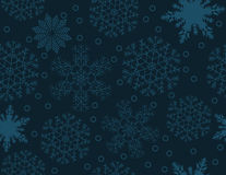 Seamless pattern of snowflakes on a dark blue background. Seamless pattern of snowflakes on a blue background, vector illustration Royalty Free Stock Images