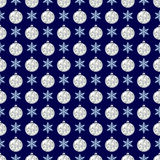 Seamless pattern with snowflakes and glittering Christmas balls. Stock Photos