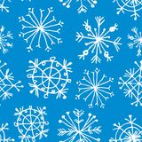 Seamless pattern with snowflakes on light blue background.. Seamless pattern with snowflakes on light blue background Royalty Free Stock Photos