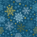 Seamless pattern of snowflakes, multicolored on blue Royalty Free Stock Image