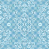 Seamless pattern snowflakes and polka dots on blue background vector. Christmas lace fabric or wrapping paper design illustration Royalty Free Stock Photography