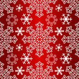 Seamless Pattern with Snowflakes on a red Background Royalty Free Stock Photos