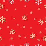 Seamless pattern with snowflakes on a red background Royalty Free Stock Image