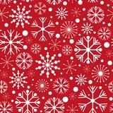 Seamless pattern with snowflakes on red background. Vector illustration. Stock Photography