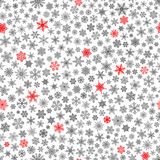 Seamless pattern of snowflakes, red and black on white. Christmas seamless pattern of small snowflakes, red and black on white Royalty Free Stock Photography