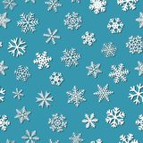Seamless pattern of snowflakes with shadows. Christmas seamless pattern of snowflakes with shadows, white on light blue background Royalty Free Stock Photo