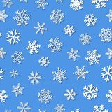 Seamless pattern of snowflakes with shadows. Christmas seamless pattern of snowflakes with shadows, white on light blue background Royalty Free Stock Images