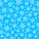 Seamless pattern of snowflakes, white on blue Royalty Free Stock Photography