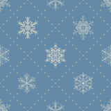 Seamless pattern of snowflakes, white on blue Royalty Free Stock Images