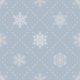 Seamless pattern of snowflakes, white on gray Royalty Free Stock Photo