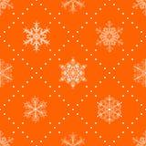 Seamless pattern of snowflakes, white on orange Stock Images
