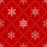 Seamless pattern of snowflakes, white on red Stock Images