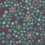 Seamless pattern of snowflakes, white, red and gray on dark gray Royalty Free Stock Photos
