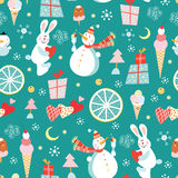 Seamless pattern of snowmen and ice cream and rabb. Seamless pattern of funny bunnies and snowmen and ice cream on a blue background with gifts Royalty Free Stock Images