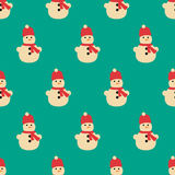 A seamless pattern of snowmen and snowflakes. Christmas seamless pattern. Royalty Free Stock Images