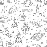 Seamless pattern with space objects, ufo, rockets, aliens. Hand-drawn elements in space theme Royalty Free Stock Photo
