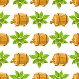 Seamless pattern with a sprig of hops and a wooden beer barrel.  royalty free stock photography