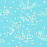 Seamless pattern with spring birds, swallows and hearts. Romantic or valentines day print. Stock Image