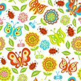 Seamless pattern of spring flowers, butterflies. Leaves Royalty Free Stock Photography