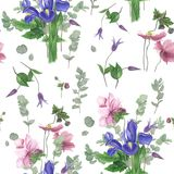 Pattern with spring flowers, watercolor painting. Seamless pattern with spring flowers: iris, anemones, clematis and branches of eucalyptus, watercolor painting Stock Photo