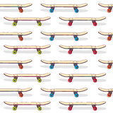 Seamless pattern of standing skateboards. The Royalty Free Stock Images