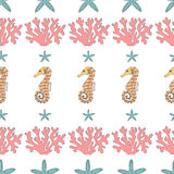 Seamless pattern of  starfish,coral and seahorses. Royalty Free Stock Images