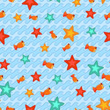 Seamless pattern of stars and fishes. Stock Image
