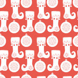 Seamless pattern with stocking and Christmas ball. Flat elements in white color on a red background. Vector illustration. It can be used for design of packing Royalty Free Stock Photos